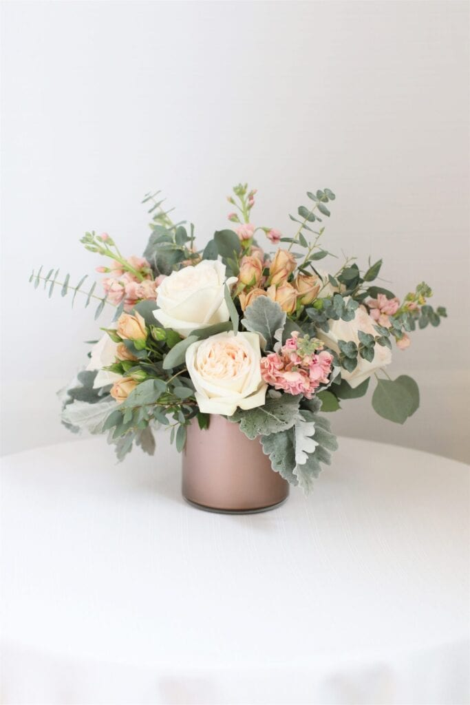 vase of white and pink roses