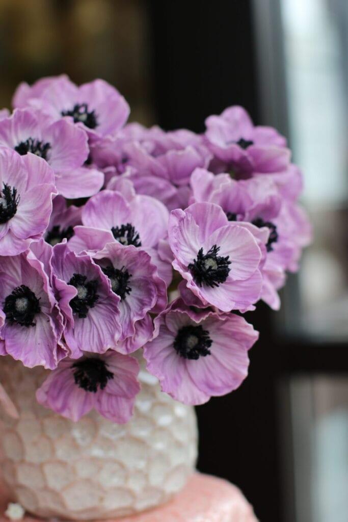 vase of violet anemones